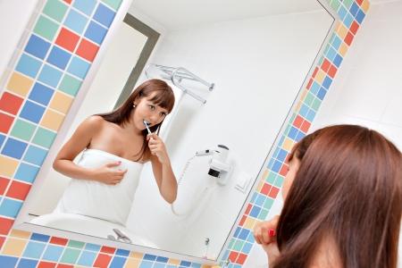 Dental care Woman cleans a teeth