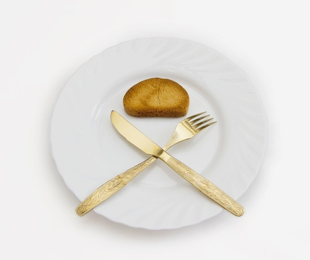 starvation: Rusk on a plate Stock Photo
