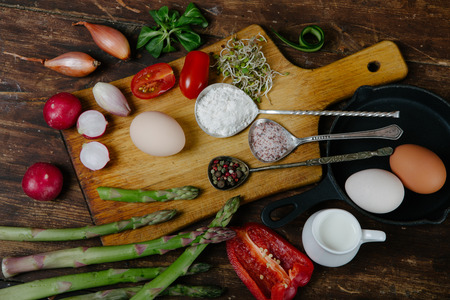 measuring cup: Frittata with asparagus ingredients on wooden table