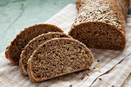 Fresh sliced italian Ciabatta bread on wooden background
