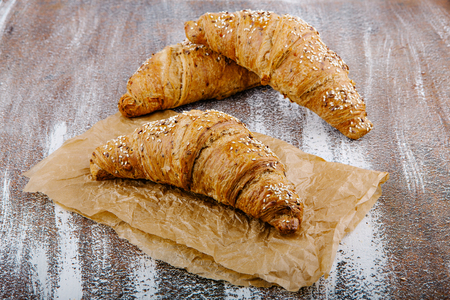 Tasty buttery croissants on bacground from wholemeal flour