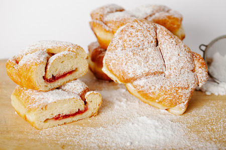 sweet pastry: baked pastry with jam filling on table background, homemade bakery Stock Photo