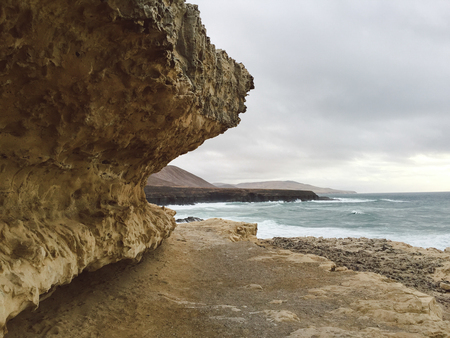 View to Ajuy coastline with vulcanic mountains on Fuerteventura island, Canary Islands, Spain