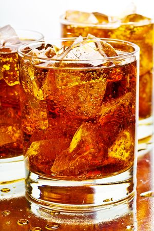 Close up view of the cola in glass photo