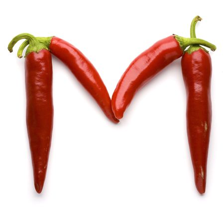 Close up view of the letter M made of pepper