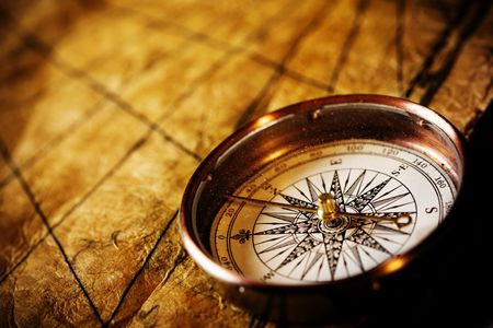 Close up view of the Compass on the old paper background Imagens