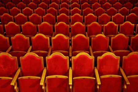 Photograph of the Rows of theatre seats Фото со стока