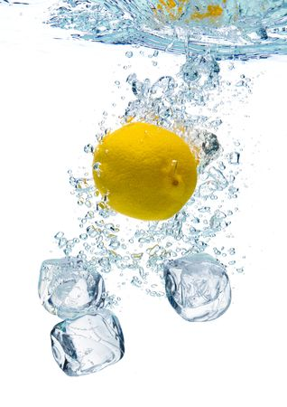 A background of bubbles forming in blue water after ice cubes and lemon are dropped into it.