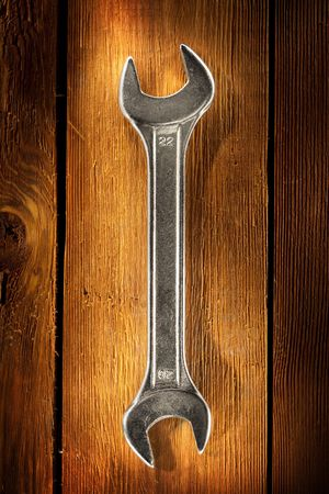 Close up view of spanner on wood board Stock Photo - 4883291