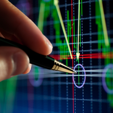 'hart on computer monitor, market's climbing, hand and pen pointer