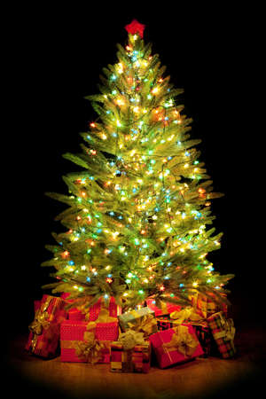 Christmas fir tree with colorful lights and decorations