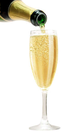 Champagne pouring in glass isolated on white photo