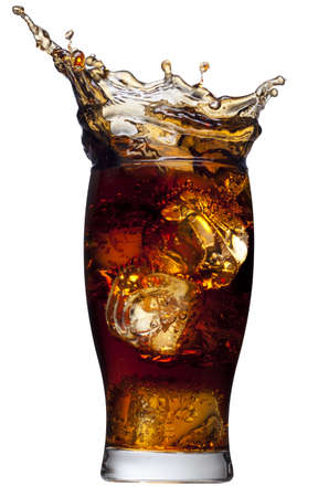 cola: Ice cube droped in cola glass and cola splashing