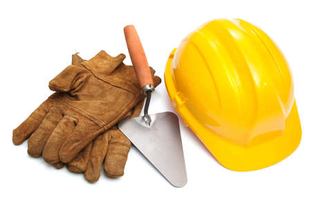 Yellow hardhat and old leather gloves isolated on white background photo