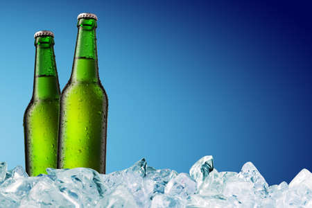 green beer: cold beer bottle with water droplets on surface