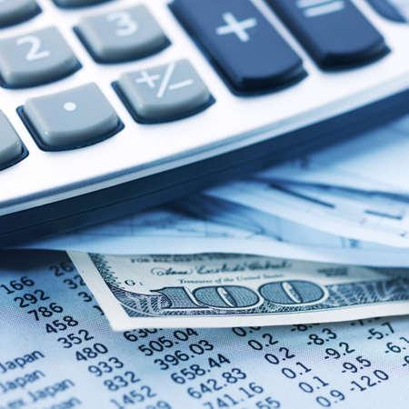 Financial concept. Calculator and pen.  shallow DOF. photo