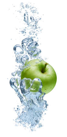 fruit in water: Green apple under water with a trail of transparent bubbles. Stock Photo