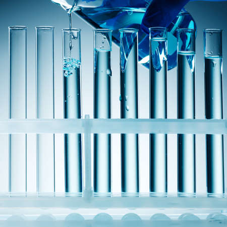 laboratory equipment: Close up view of Test Tubes on blue