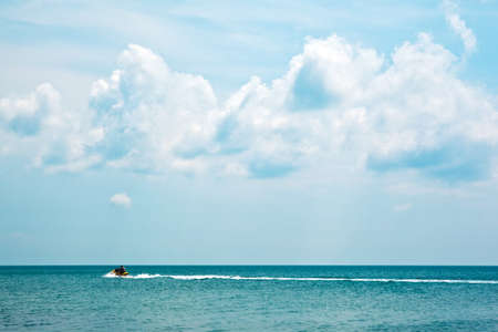 The view of ocean and sky with a boat in distance photo