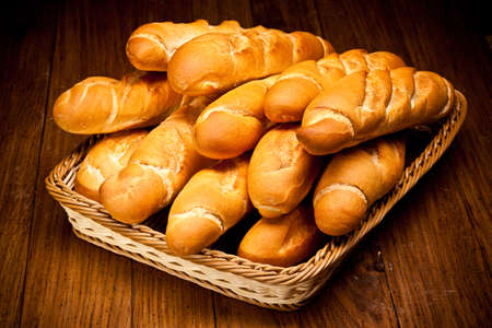 french loaf: assortment of baked bread on wood table