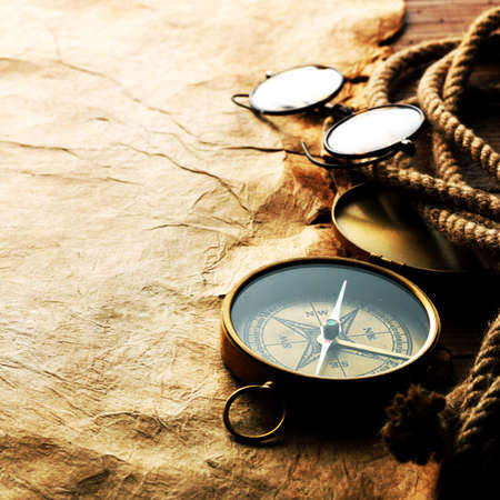 ir�ny: Compass, rope and glasses on old paper