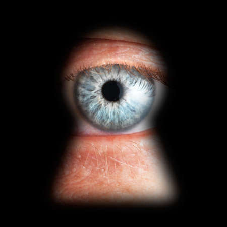 Eye in keyhole, isolated on black background Stock Photo - 7939897