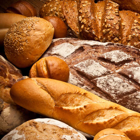 fresh baked: assortment of baked bread on wood table