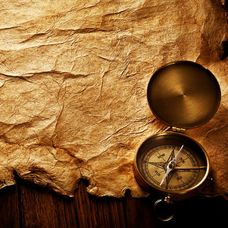 Close up view of the compass on old paper photo