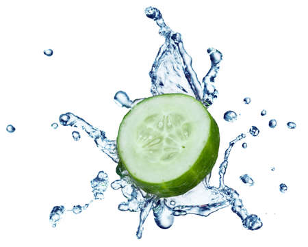 cucumber in spray of water. Juicy cucumber with splash on background photo