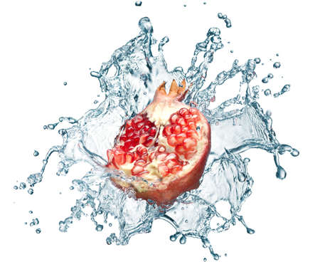 Pomegranate in spray of water. Juicy Pomegranate with splash on white background photo