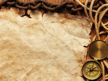 map compass: Compass, rope, paper, chain on wooden board