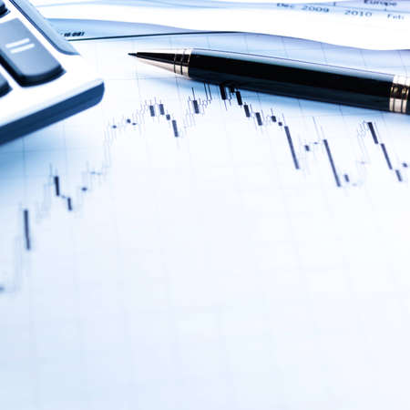 finance background: Financial concept. Calculator and pen.  shallow DOF.