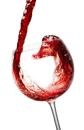 red wine splashing in a glass, isolated on white photo