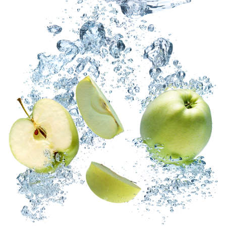 green apple: Apple falls deeply under water with a big splash.