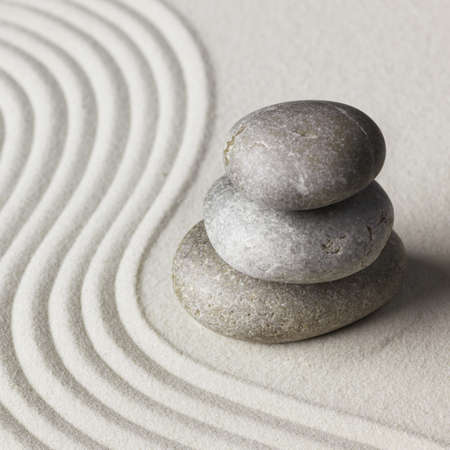 Zen stone in the sand. Background photo