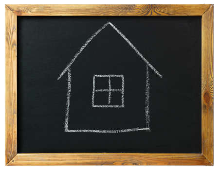 house on black chalk board isolated on white photo
