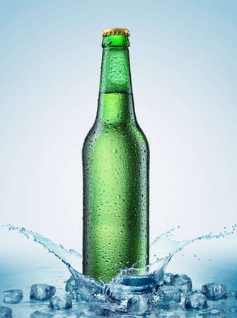 beer bottle being poured in a water with ice Stock Photo - 12569039