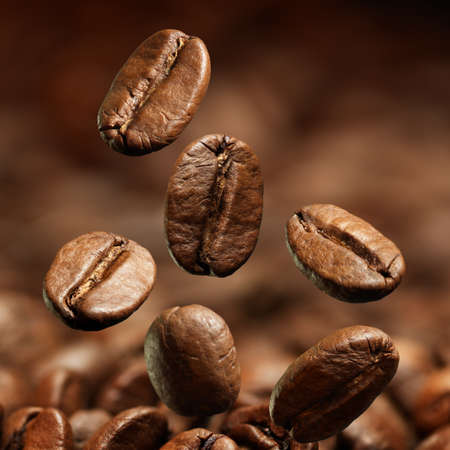 Closeup of coffee beans with focus on one Stock Photo