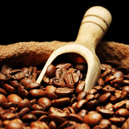 coffee sack: Coffee beans on burlap sack with wooden scoop Stock Photo