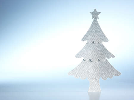 christmas card background: Christmas tree paper cutting design card. Stock Photo