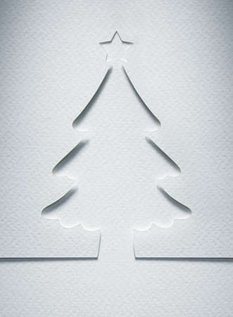 Christmas tree paper cutting design card. photo