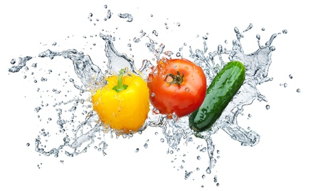 Juicy tomato, cucumber, pepper in spray of water   Stock Photo