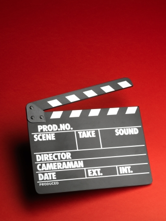 Clapper board on red background Banco de Imagens