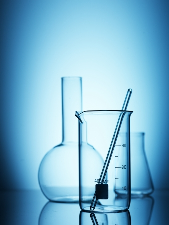 Laboratory glassware on color  Stock Photo
