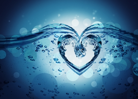 Heart from water splash with bubbles isolated on white