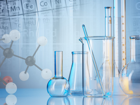 Laboratory glassware on color background