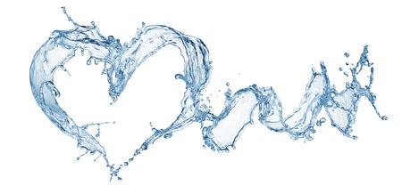 白で隔離の泡と水のしぶきからの心 写真素材