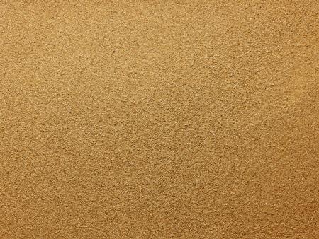 シームレスな砂の背景。クローズ アップ