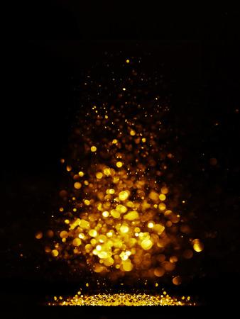 glitter vintage lights background. dark gold and black. defocused. Christmas card Standard-Bild