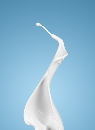 milk or white liquid splash on blue background. isolated Stockfoto
